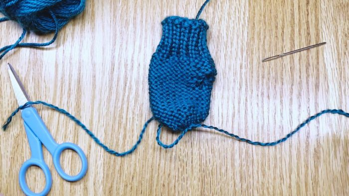 Step 19: Weave in the yarn tail to finish mitten fingertips a knitting lesson with Liz Chandler @PurlsAndPixels.