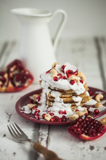 Recipe for Cashew Butter Coconut Milk Pancakes with a Curd Coconut Topping garnished with Cashew Seeds and Pomegranate