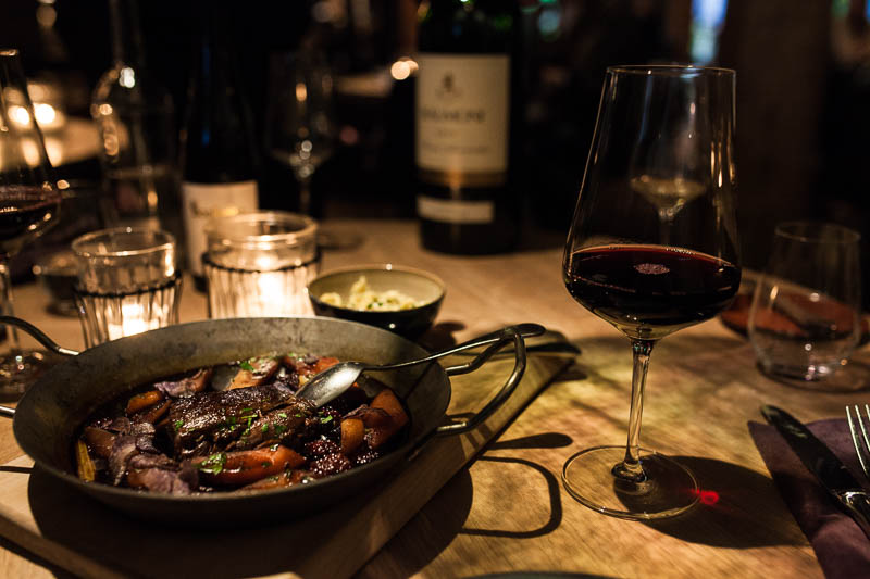 Deer shoulder with redwine sauce, braised vegetables and homemade pasta at the Hygge Restaurant Hamburg