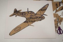 "The second stage of making the ""Spitfire MK VB"" 3D Acrylic Painting: cutting out and sticking together the cardboard to create layers that make it 3D"