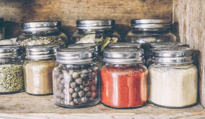 Black pepper in a jar with other condiments