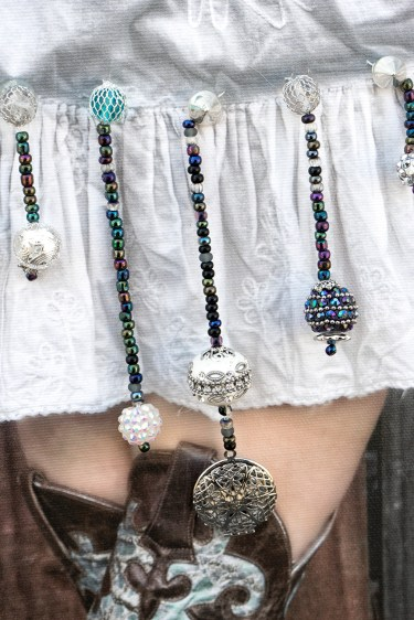Boots and skirts with beads and a locket