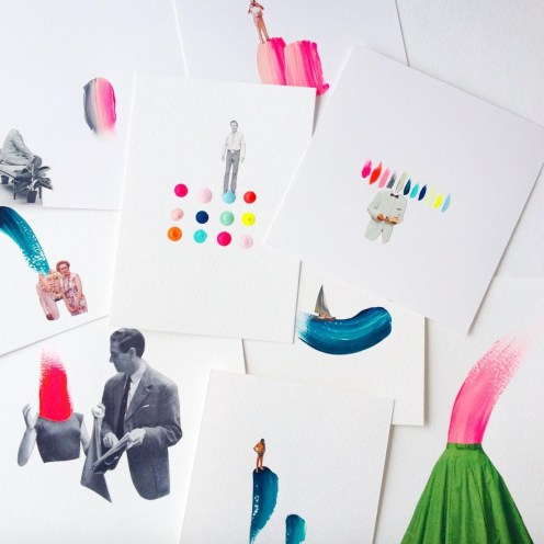 Still life photo of a group of paper collages seen from above.