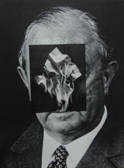Man photo portrait with a paper cut that covers his face.