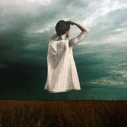 Woman seen from the back that is watching a storm.