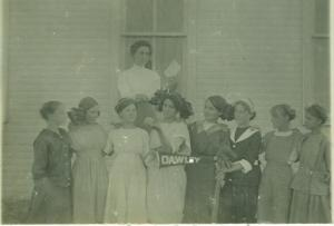 Ina (second from left) school photo