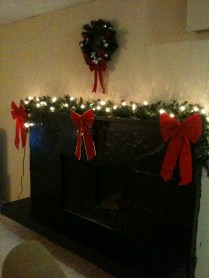 Our Christmas decorations on our fireplace!