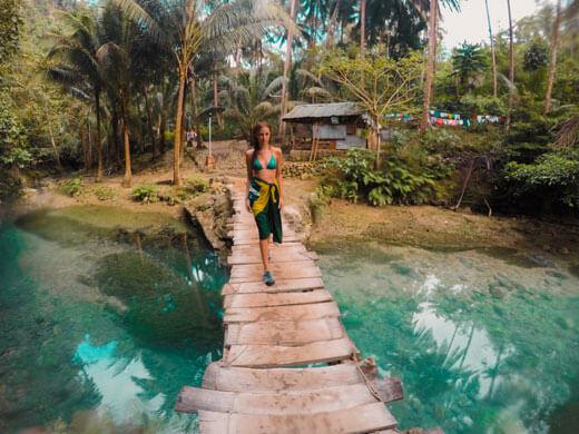 Nanda crossing a bridge leading to Kawasan Falls