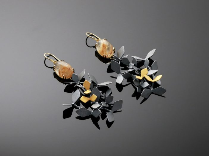 Artist: Chao-Hsien Kuo Title: Black Forest Sunshine earrings 4KB Materials: 925 o/oo silver, 750 o/oo yellow gold, 24K gold foil, rutile quartz Year: 2018 Photographer: Chao-Hsien Kuo