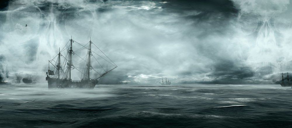 Ghost ship on misty, mysterious stormy sea