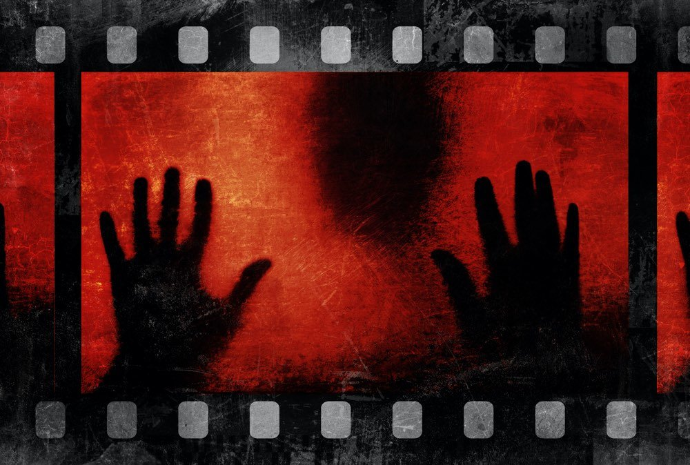 black silhouette and scary film strip