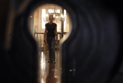 Caroline walking down the hallway in The Skeleton Key