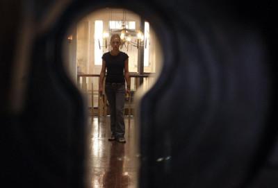 Caroline walking down the hallway in The Skeleton Key