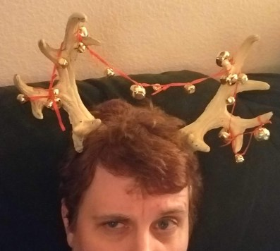 Author Kris Silva wearing antlers