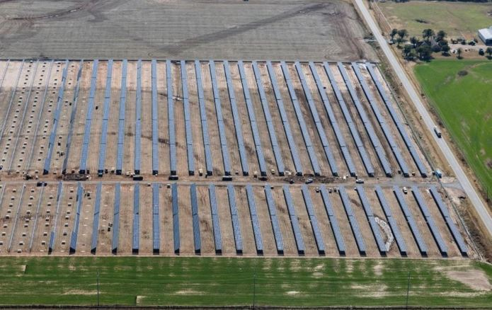 Note unfinished left side of image - with solar module pallets on ground. [Photos provided by Oklahoma Gas and Electric Co.]