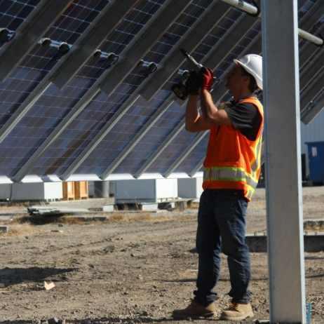 A NEXTracker engineer works on an NX Gemini smart solar tracker.