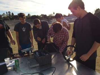 Palos Verdes Institute of Technology | PVIT - First Robotics -- photo of students working on neighborhood electric vehicle