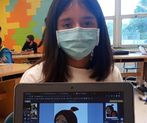 Student posing with her computer artwork