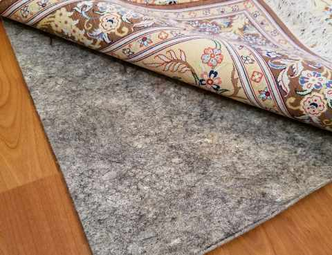 Persian Ghom laying on rug pad in customers home in Scottsdale AZ