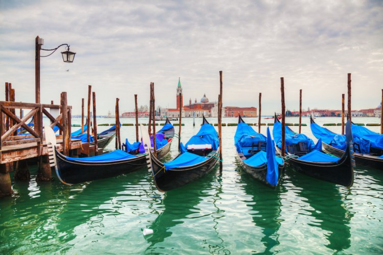 Gondolas floating in the Grand Canal on a cloudy day