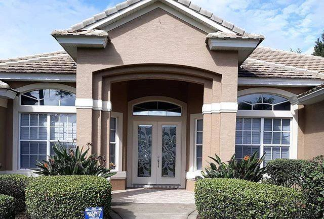 Residential Window Tinting on a house. Professional Window Tinting of Central FL LLC home