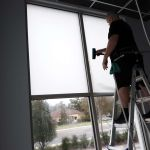 Installing frost window film on glass at Casa Leon Jewelers in Lake Mary