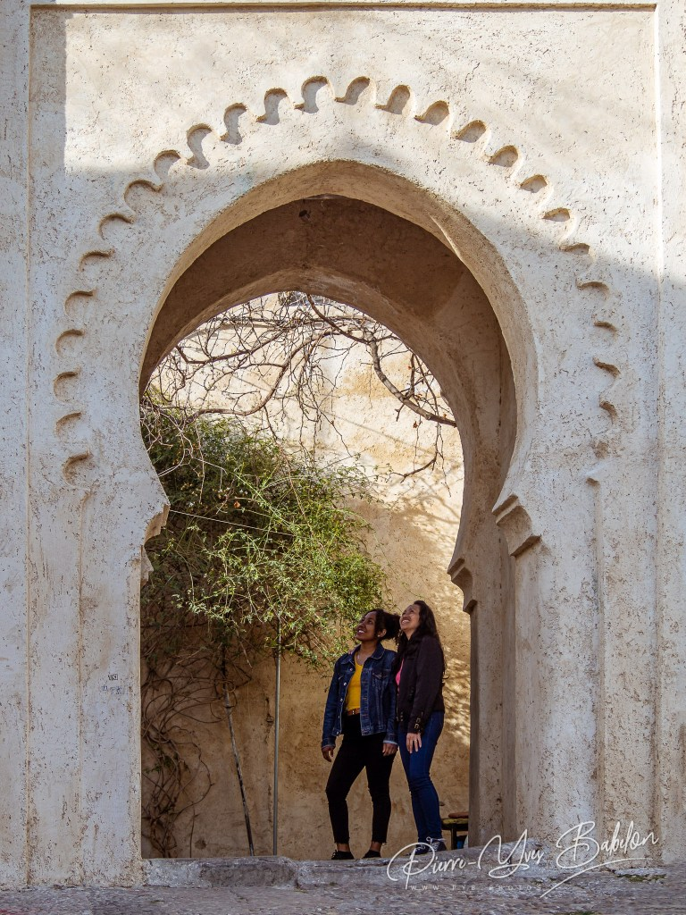 Tourists under the gateway of the kasbah of Tangier