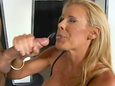 nicole-sheridan-continues-to-stroke-his-cock-as-he-cums-on-her-face