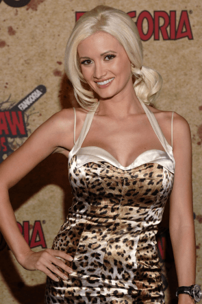 "Former Playboy model and original ""Girls Next Door"" star Holly Madison was involved with Hefner from 2003 through 2008"
