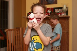 Miles was excited about the snowman he asked Santa for.