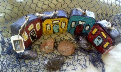 Smögen hus i fyra färger