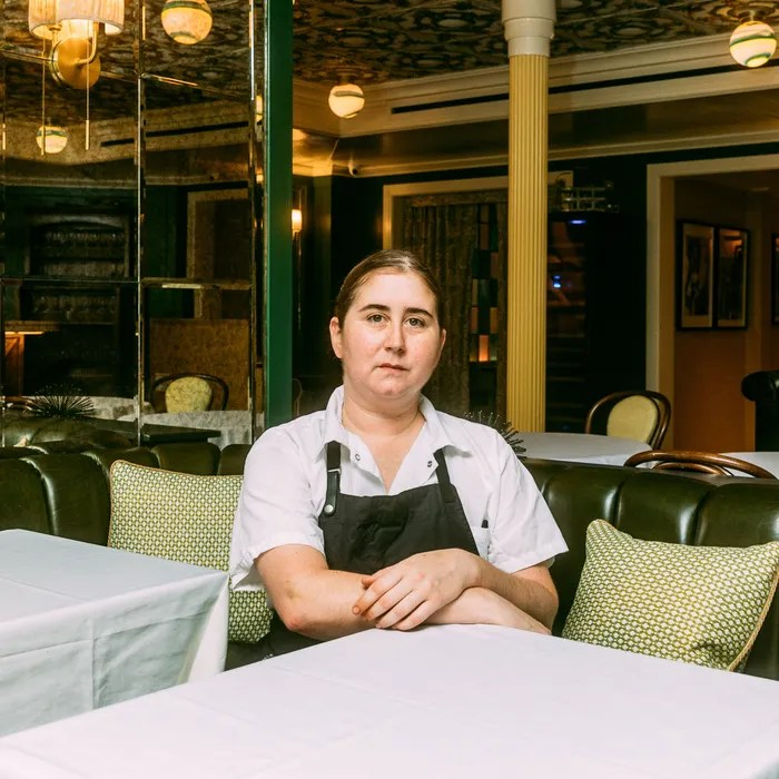 A portrait of chef Ashely Rath sitting at a table the new West Village Italian restaurant Saint Theo's.