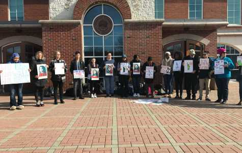 Members of the Quinnipiac community stand in solidarity on the Mount Carmel Campus