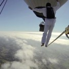 Daredevils Walk a Tightrope Between Two Hot-Air Balloons