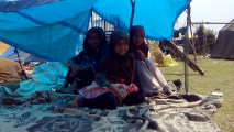 Sana (center) with her sisters, Rifat and Farhana, at the Bemina relief camp. Sana was trapped in her house and was rescued by a local. She reunited with her family three days after the floods.