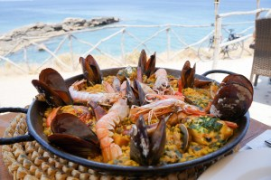 locally-sourced paella. Qbamboo top tips on travelling sustainably. Eat local food