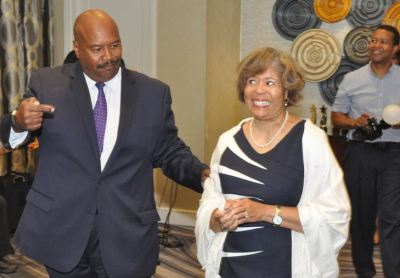 Veteran WBTV reporter Steve Crump and wife Cathy enter a hotel conference room in Charlotte where the friends, co-workers and members of the Charlotte Area Association of Black Journalists had gathered to pay tribute to Crump for his 30-plus years of local reporting, April 22, 2017. (Photo: Glenn H. Burkins)
