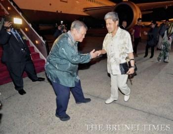 His Royal Highness Prince Mohamed Bolkiah, Minister of Foreign Affairs and Trade (right) being bid farewell by Yang Berhormat Pehin Orang Kaya Pekerma Dewa Dato Seri Setia Lim Jock Seng, at the Brunei International Airport.
