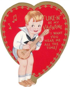 Old valentine card with a little boy with a ukulele