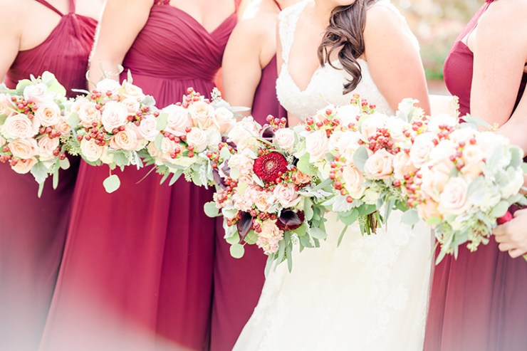 cheerful fall wedding color bridal party with beautiful maroon bouquet Zorvino vineyard Sandown Nh Q Hegarty Photography weddings and portraits
