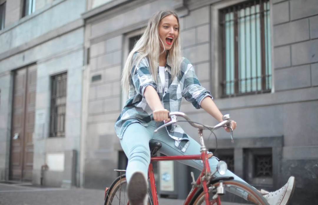 woman going wild on a bicycle