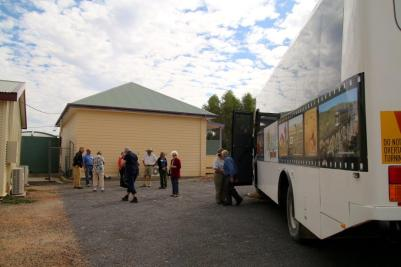 A busload of visitors arriving at the museum