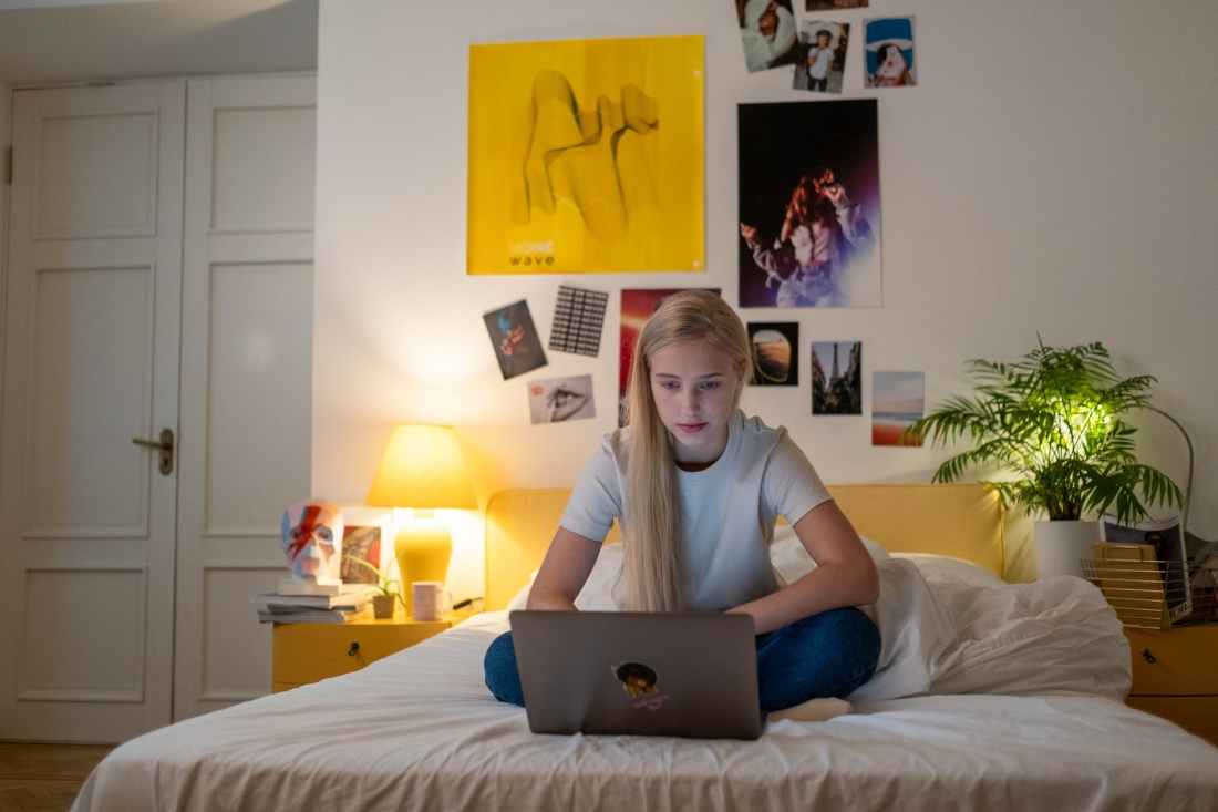 a female teenager using her laptop