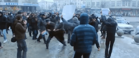 A still from a YouTube video showing altercations between gay protesters and anti-gay counter-protesters in Charlotte's Russian sister city, Voronezh, on Jan. 20, 2013.