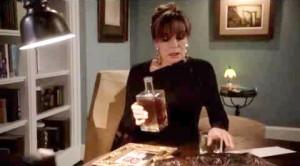 Linda Gray, in her role of Sue Ellen Ewing, sometimes had to deal with alcoholism during times of great stress, like this one depicted in the photo when she took a drink after J.R. Ewing's death (played by Larry Hagman).