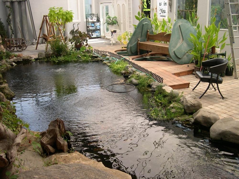 7 Most Breathtaking Koi Fish Ponds - Qnud on Backyard Koi Pond Designs  id=47915