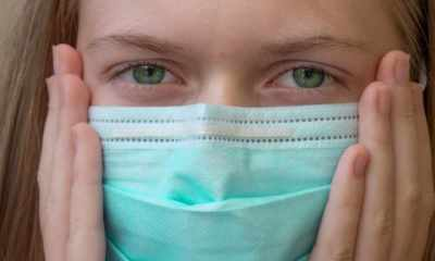 A girl wearing disposable face mask to prevent spreading of the viruses