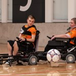 Two powerchair footballers.