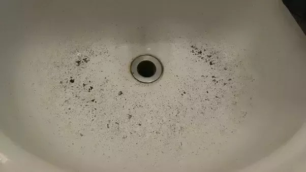 build up of black stuff in my sink