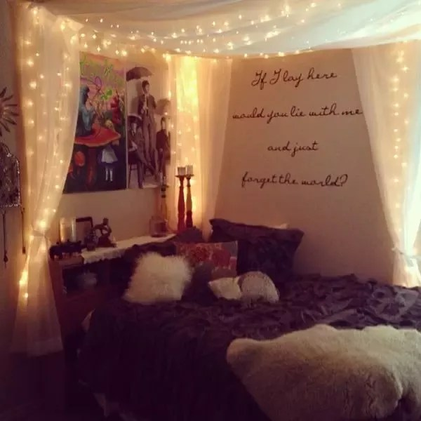 hang string lights over a bed canopy